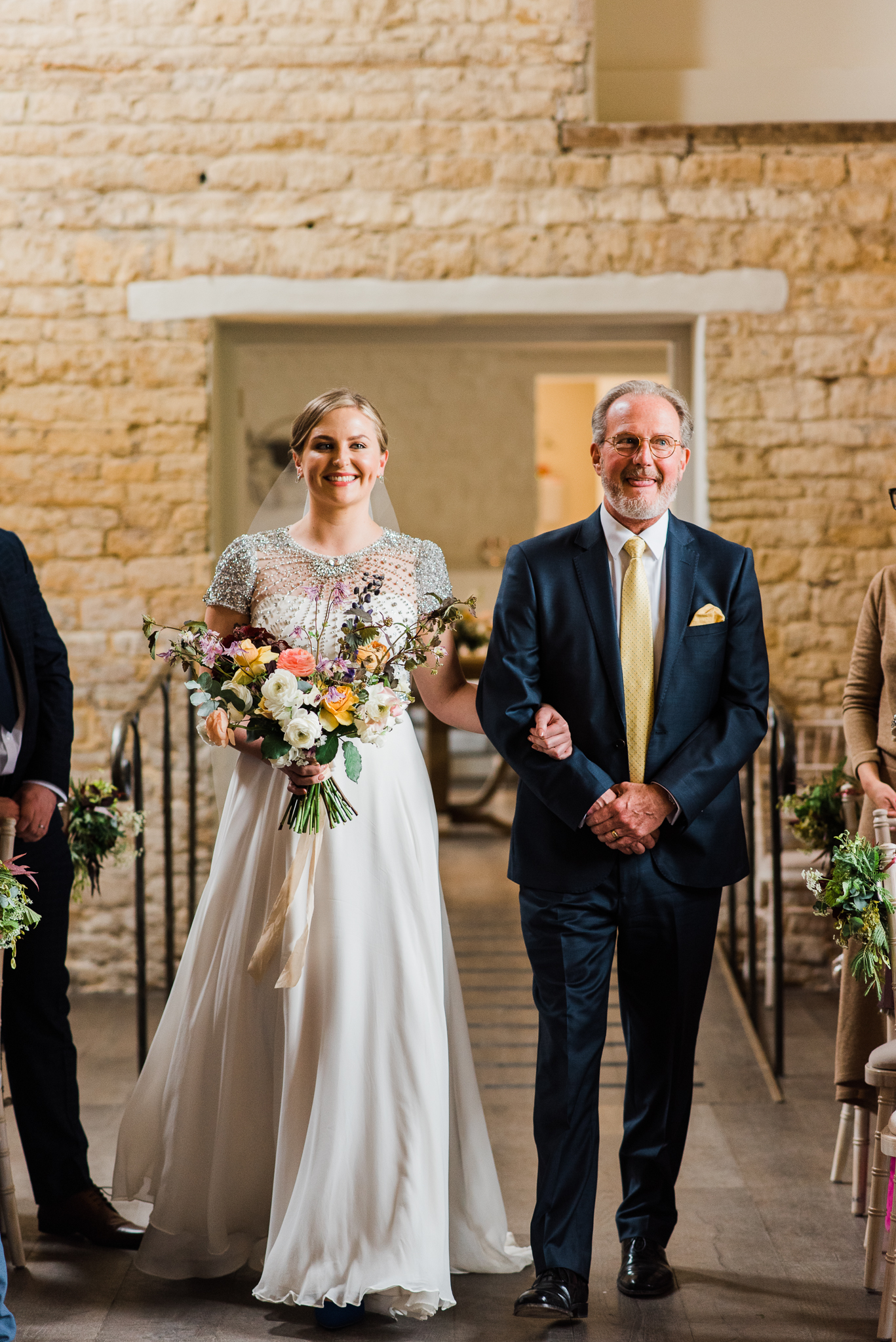 Bride walking down the aisle in Lapstone Barn