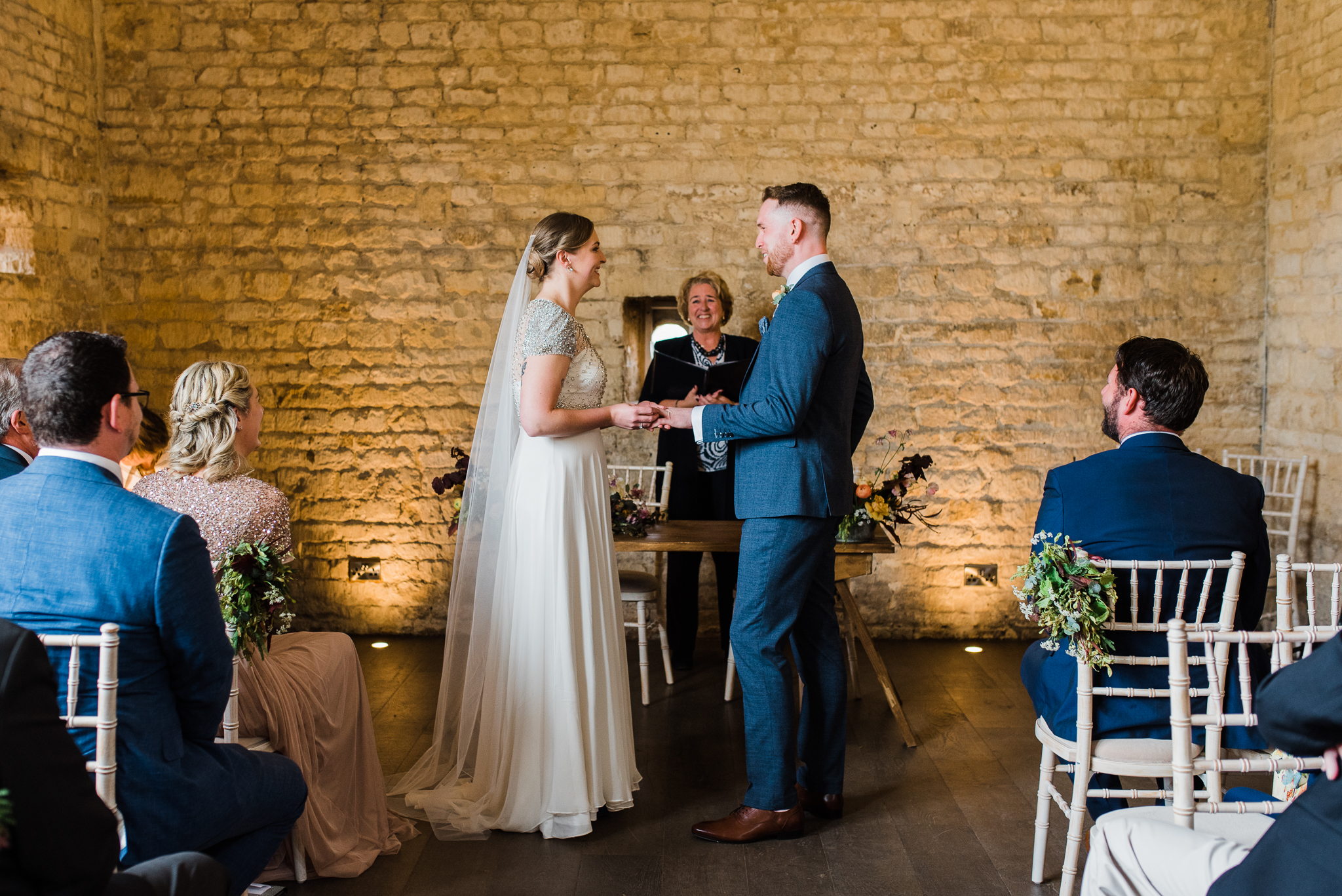 Bride and groom saying vows in Lapstone barn