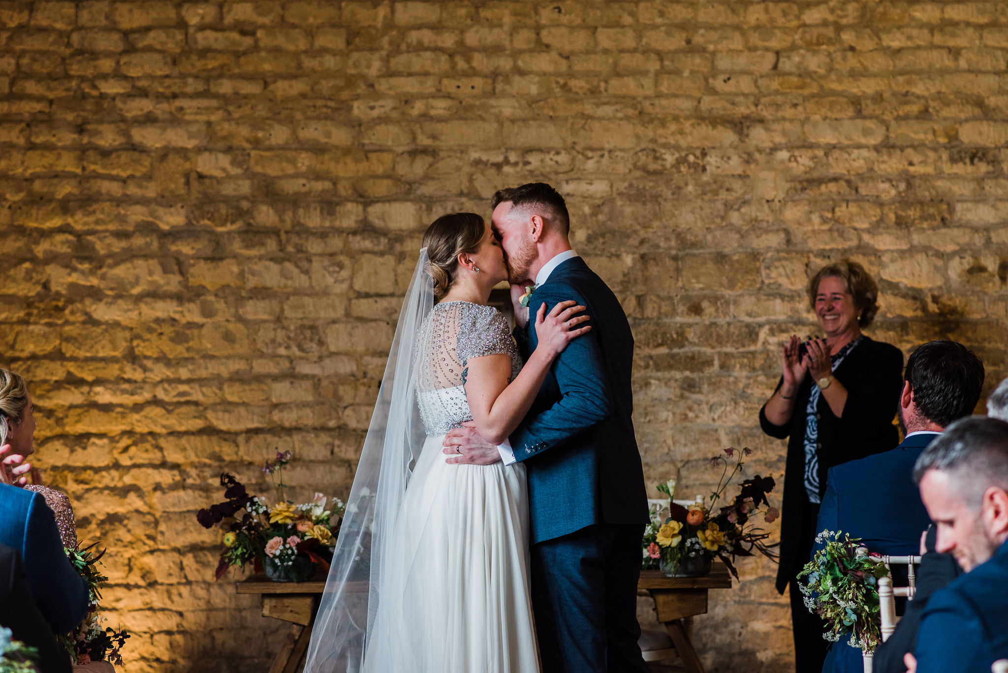 First kiss in Lapstone Barn wedding
