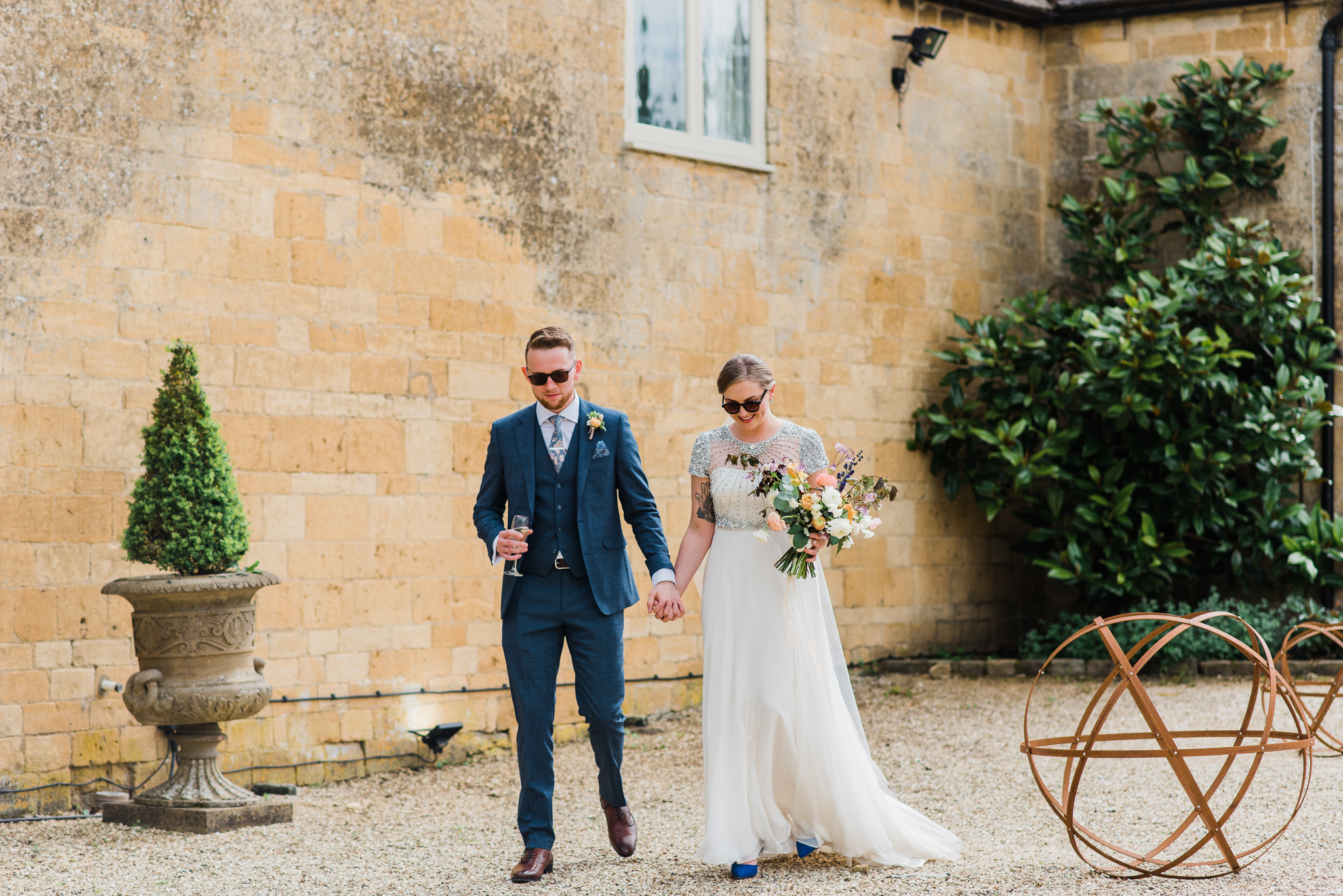 Bride and groom walking together at Lapstone barn
