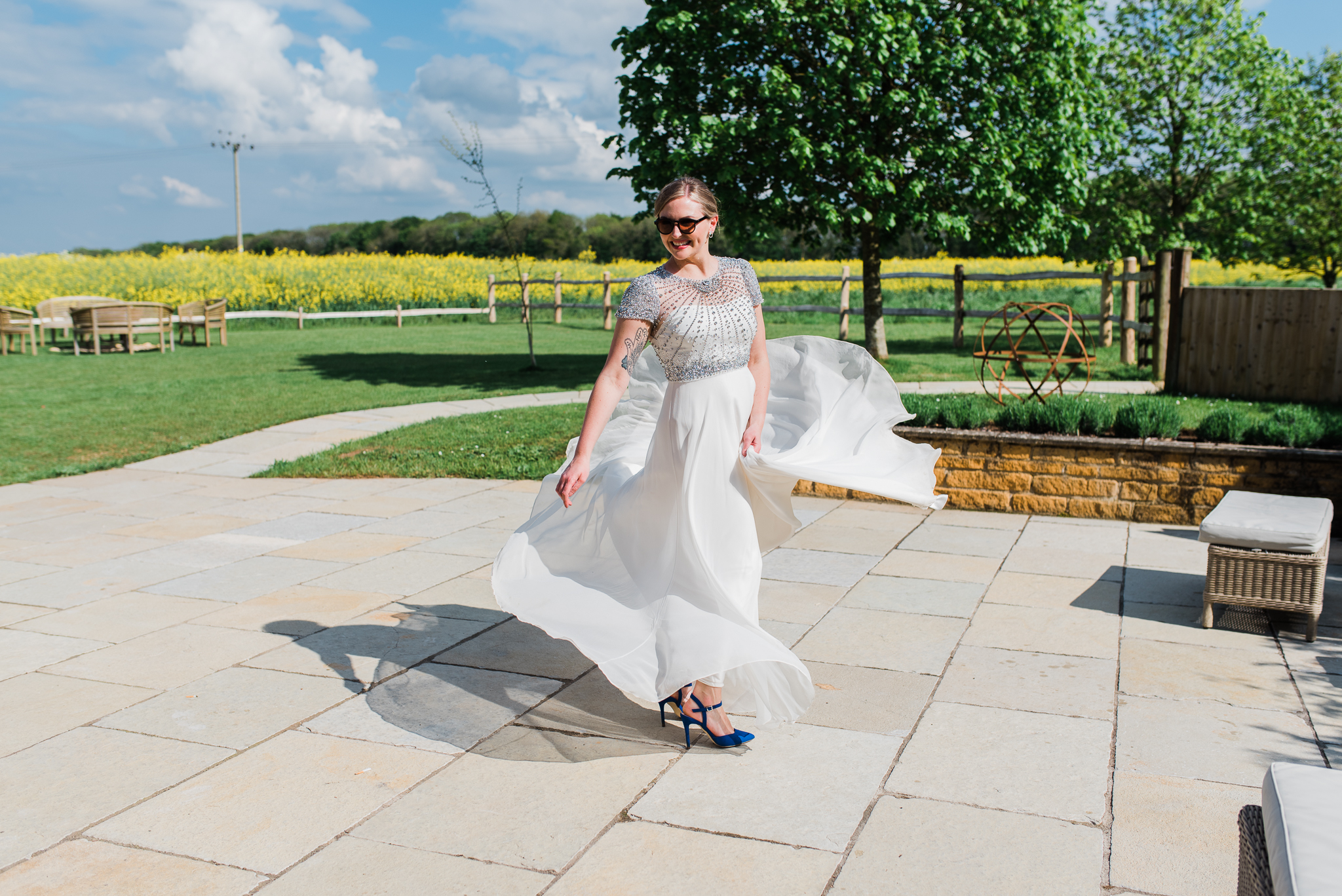 Bride twirling in Jenny Packham dress