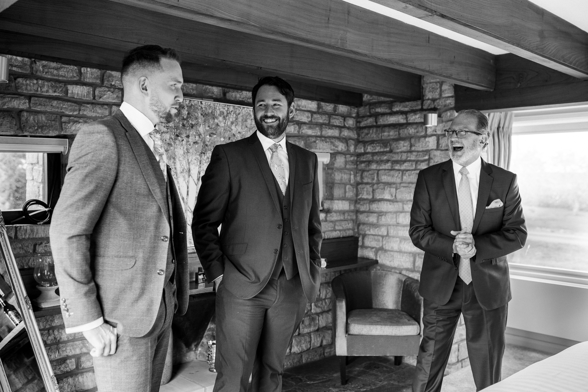 Groomsmen laughing in Lapstone Barn