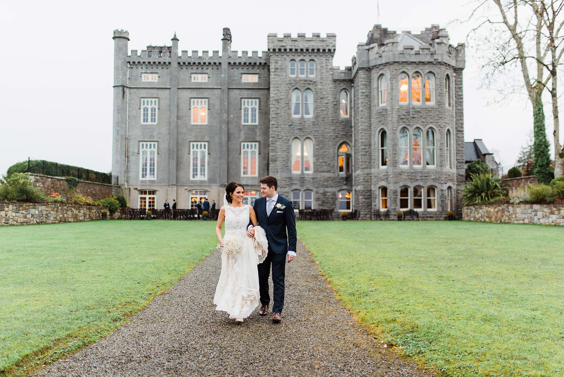 New married couple walks away from Kilronan Castle in Roscommon Ireland
