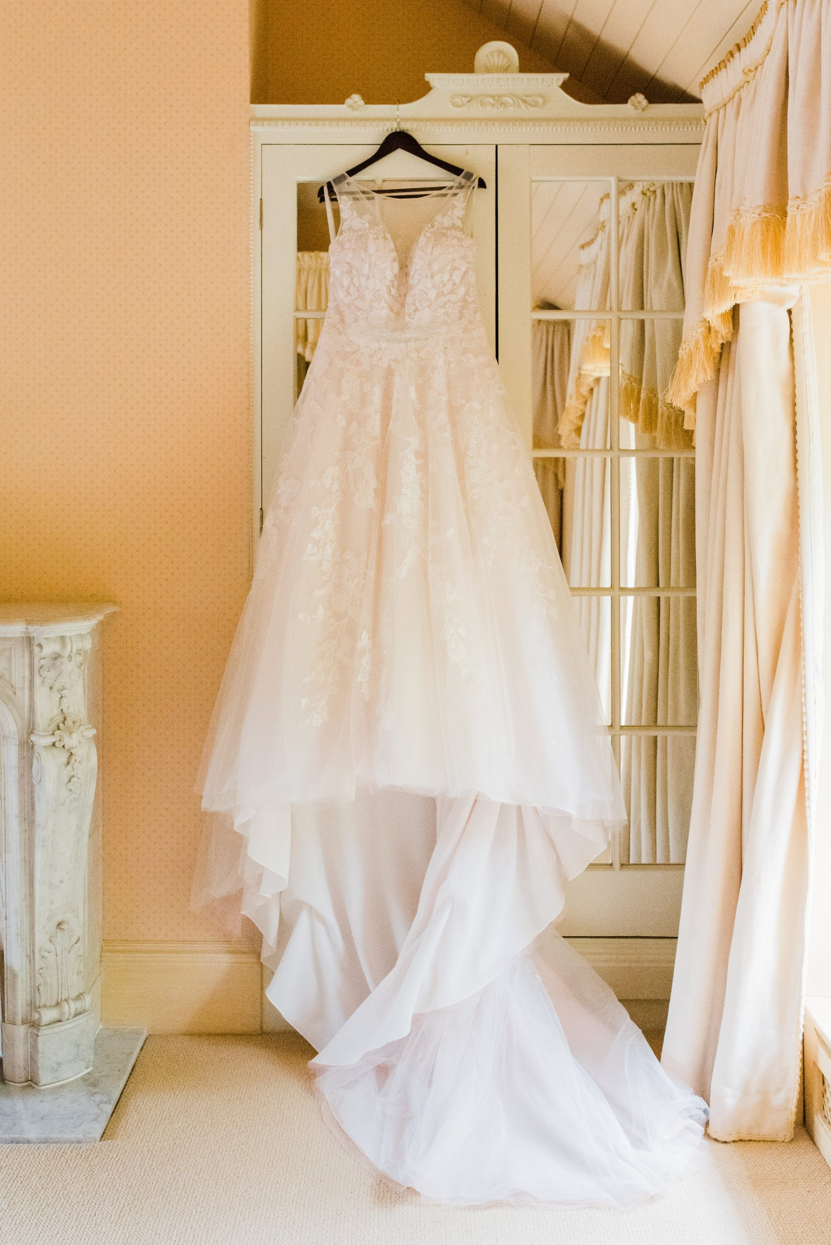 Wedding dress hanging up on a wardrobe