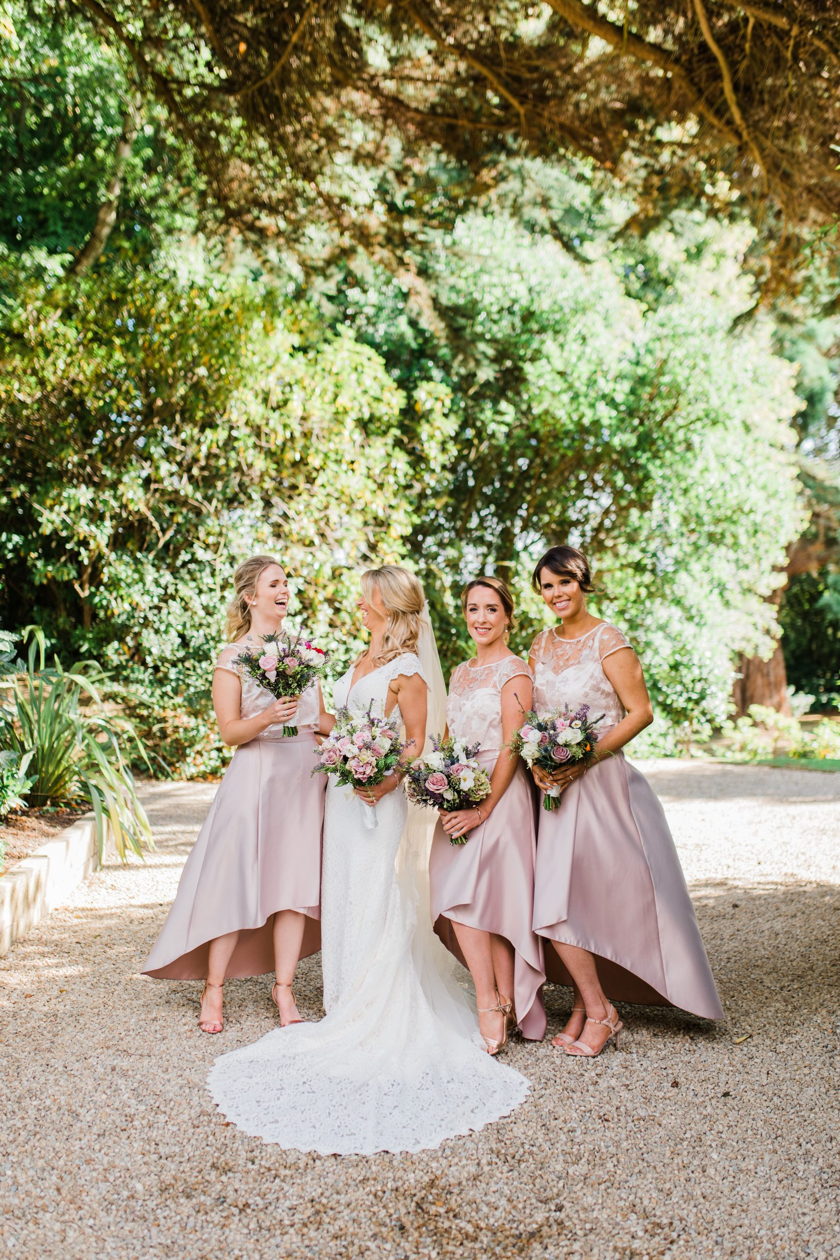 Bridesmaids laughing together on sunny day
