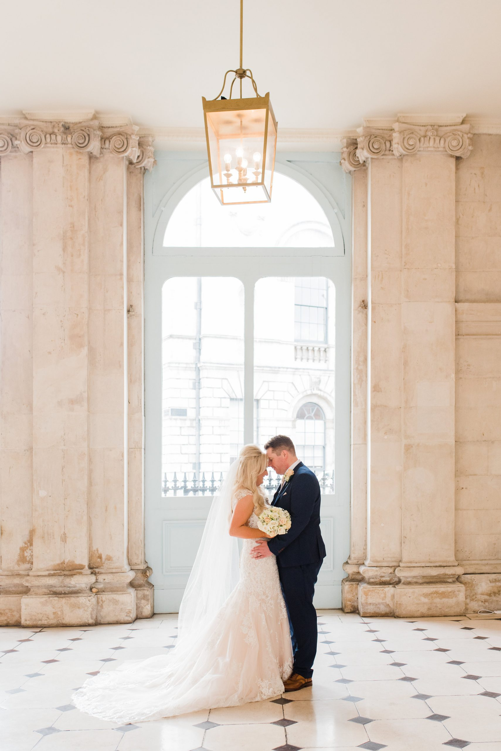 Bride and groom hugging each other in Dublin City hall