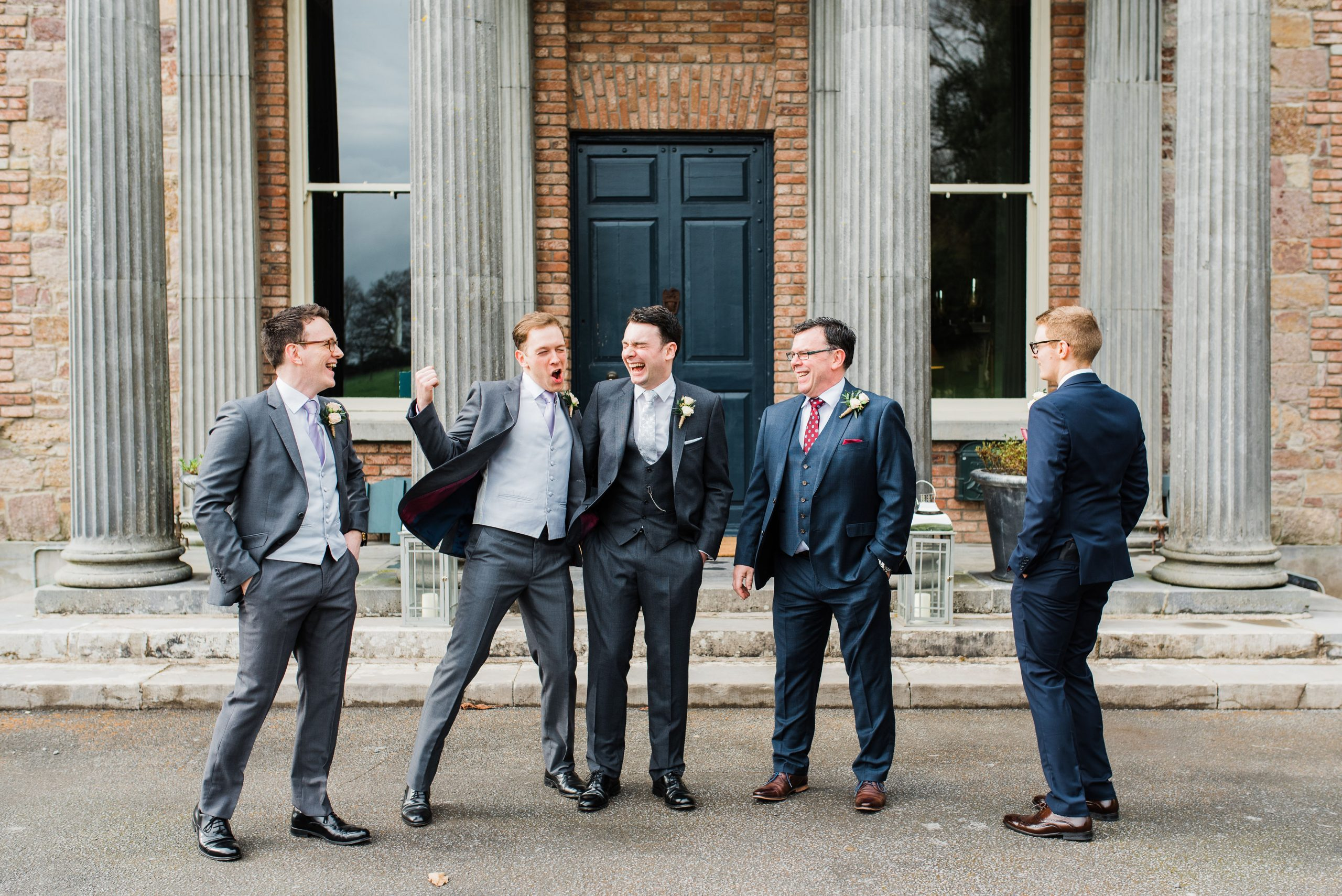 Groomsmen laughing together outside Kilshane House
