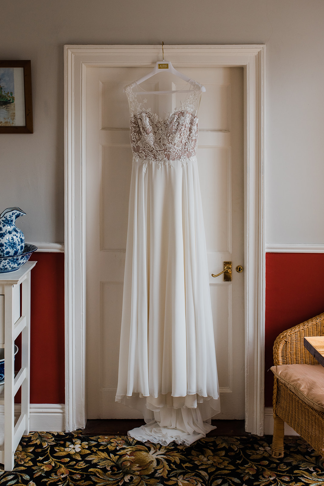 White wedding dress hanging up