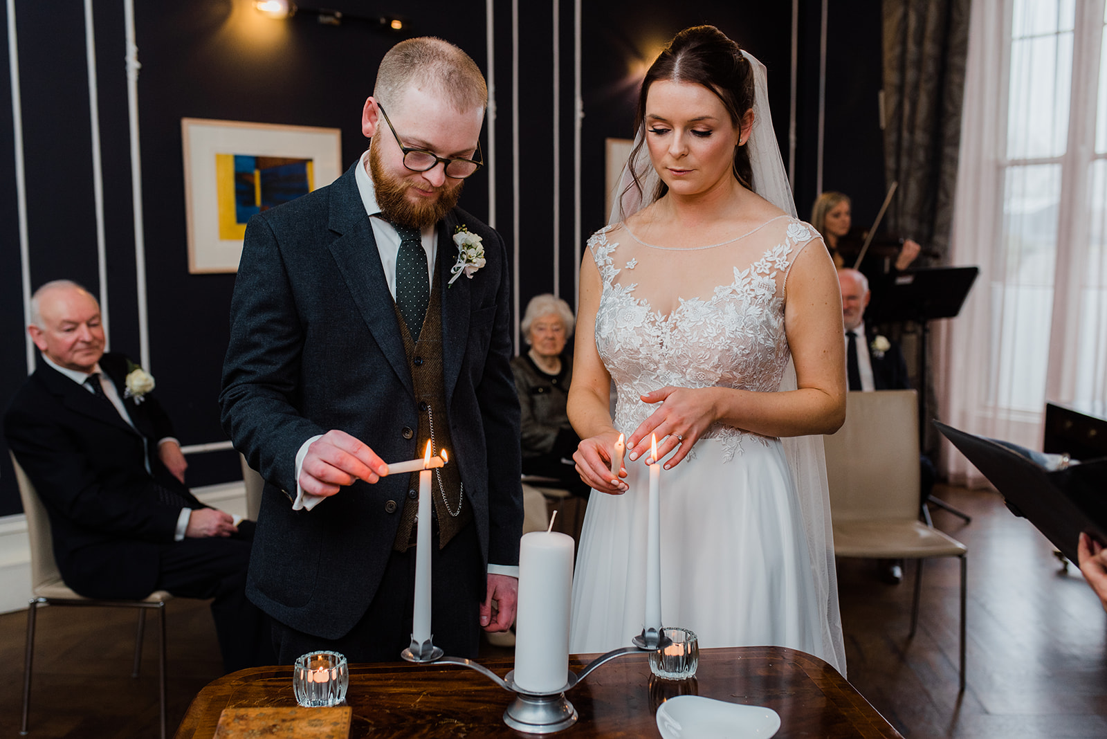 Bride and groom lighting candles