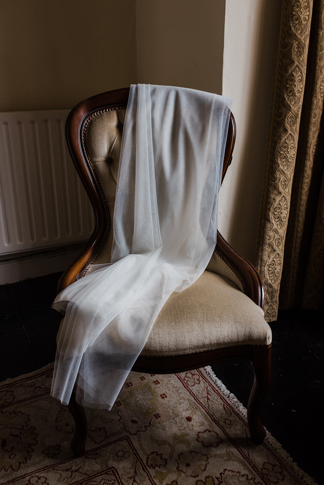 Wedding veil lying on chair