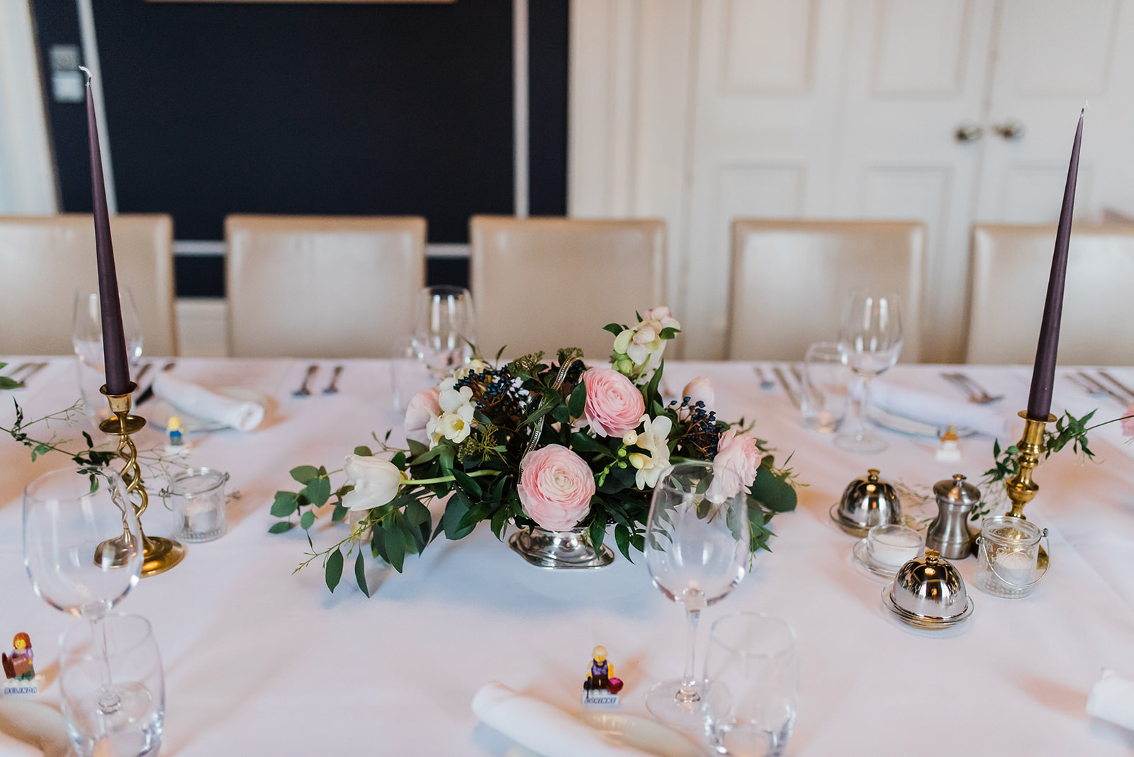 Pink floral centrepiece on table