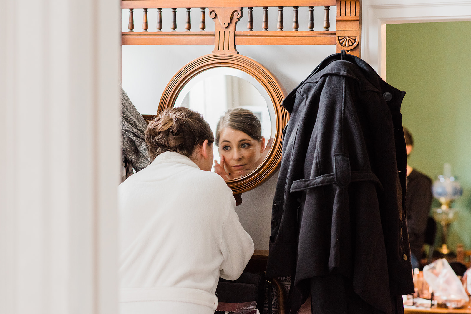 Fixing make up in the mirror