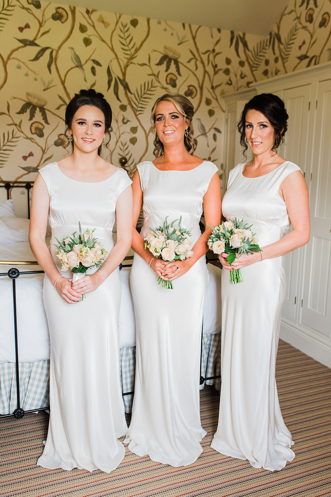 Bridesmaids in cream silk dresses at Virginia Park Lodge