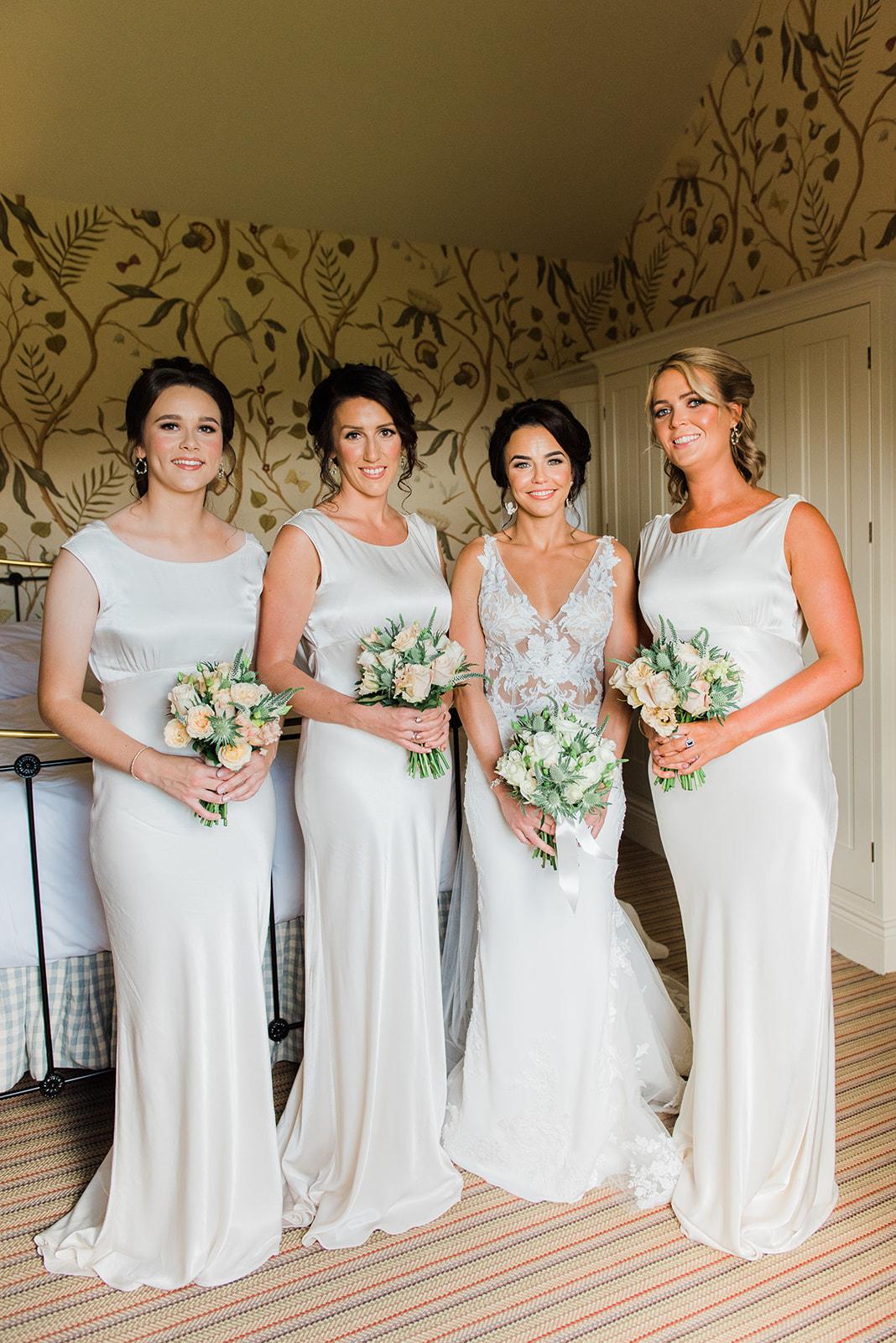 Bride with bridesmaids in Virginia Park Lodge