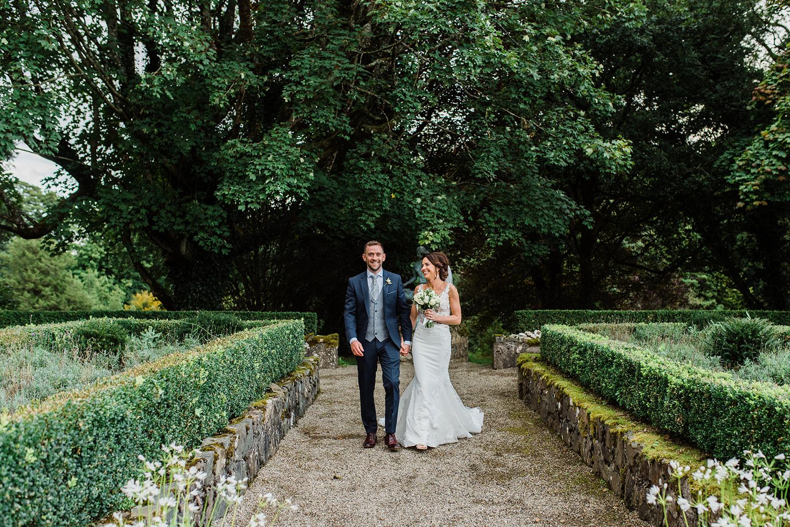 Bride and groom walking in the Partere garden in Virginia park lodge
